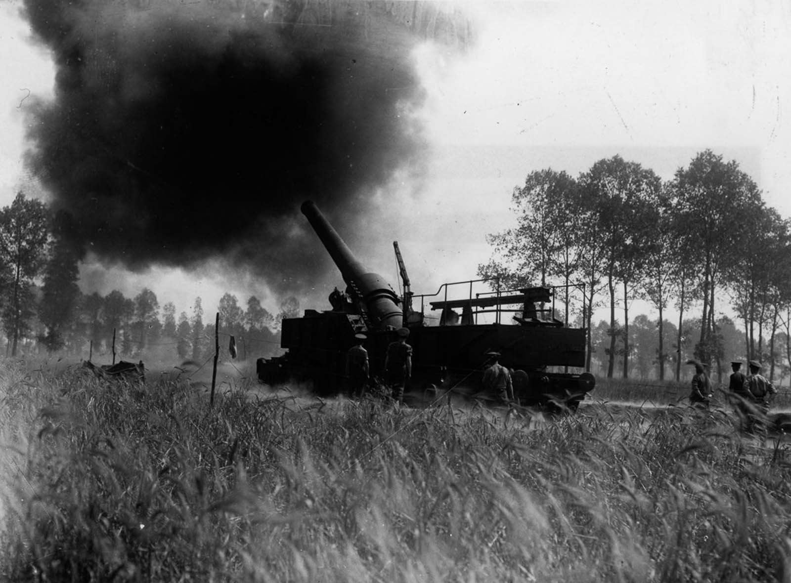 A 12-inch railway gun in action at the Somme, France. August, 1916.