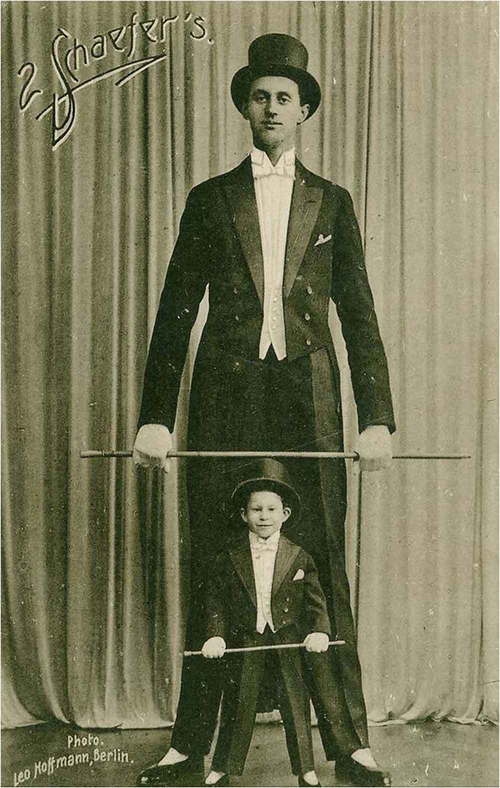 Nacken 17 as circus acrobat with a young boy assistant.