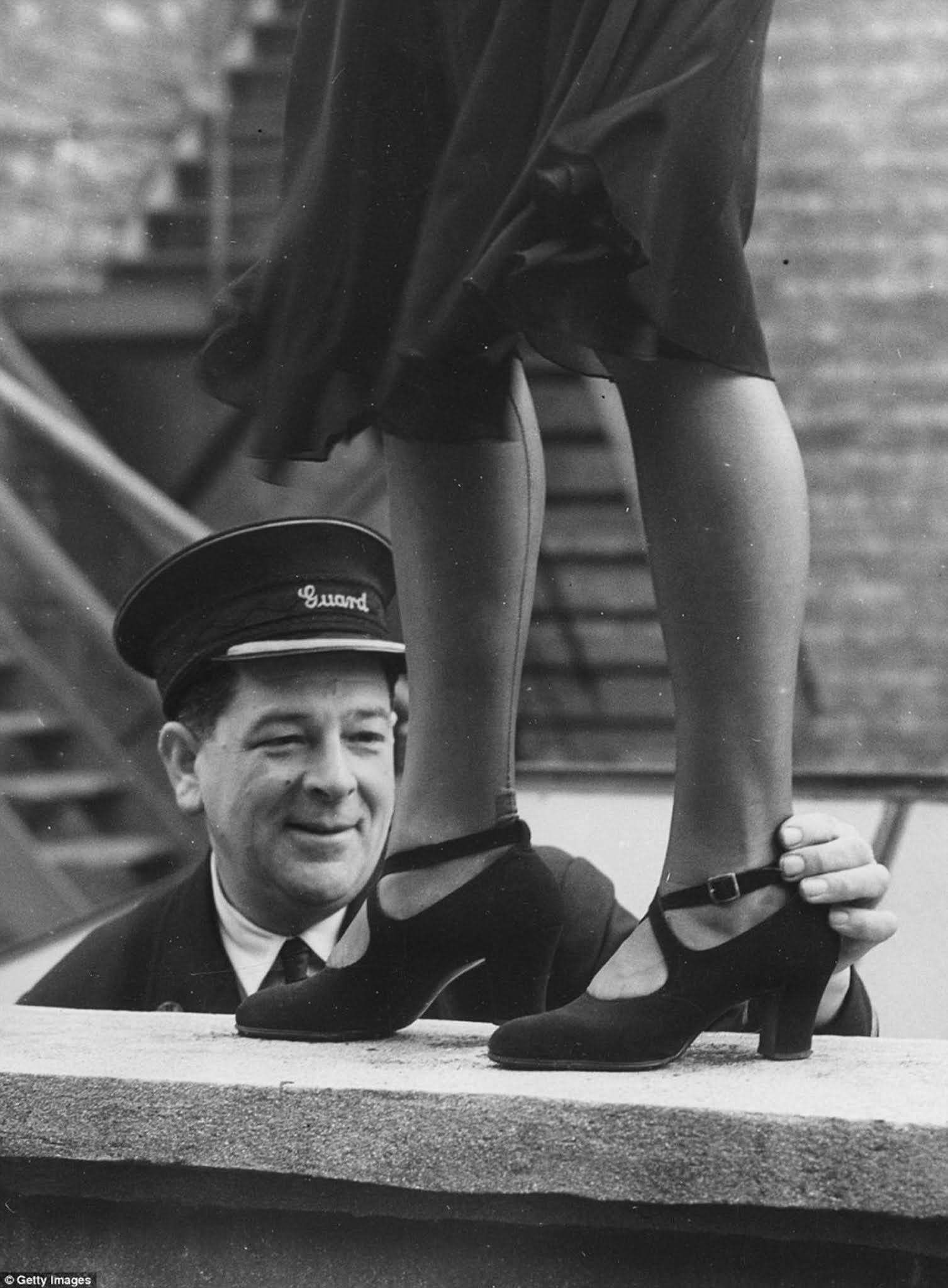 Railway guard George Wiltshire, judge of an ankle competition organised by the Women's Section of the British Railways Social Club at Oxford, with the winner, Elsie Chapman, in 1949.