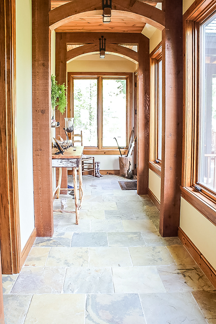 hallway with natural wooden posts stone flooring