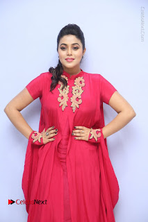 Actress Poorna Latest Stills in Red Dress at Rakshasi First Look Launch  0115.JPG