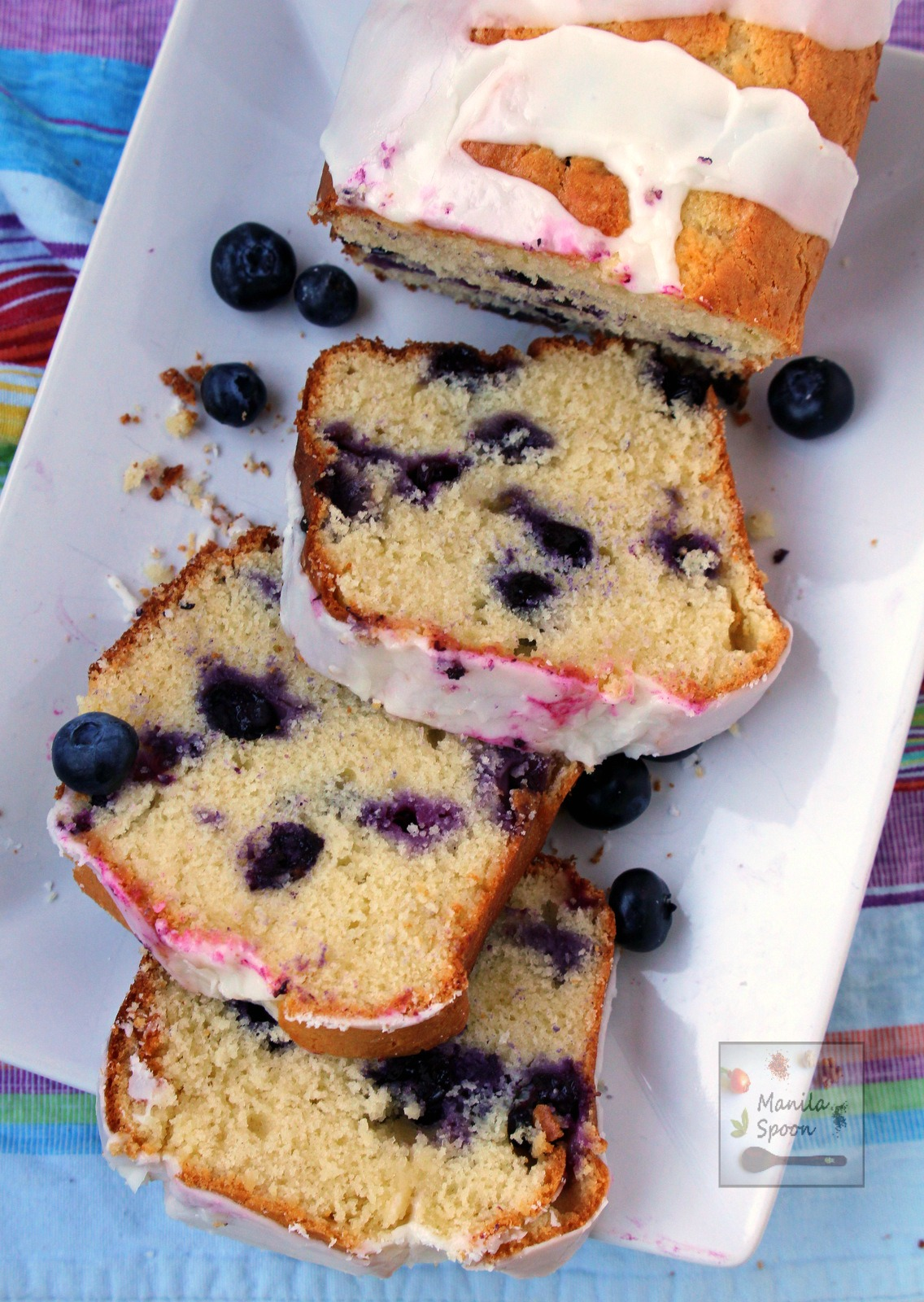 Bursting with juicy blueberries, this moist and delicious Blueberry Ricotta Pound Cake is summer's perfect cake! | manilaspoon.com