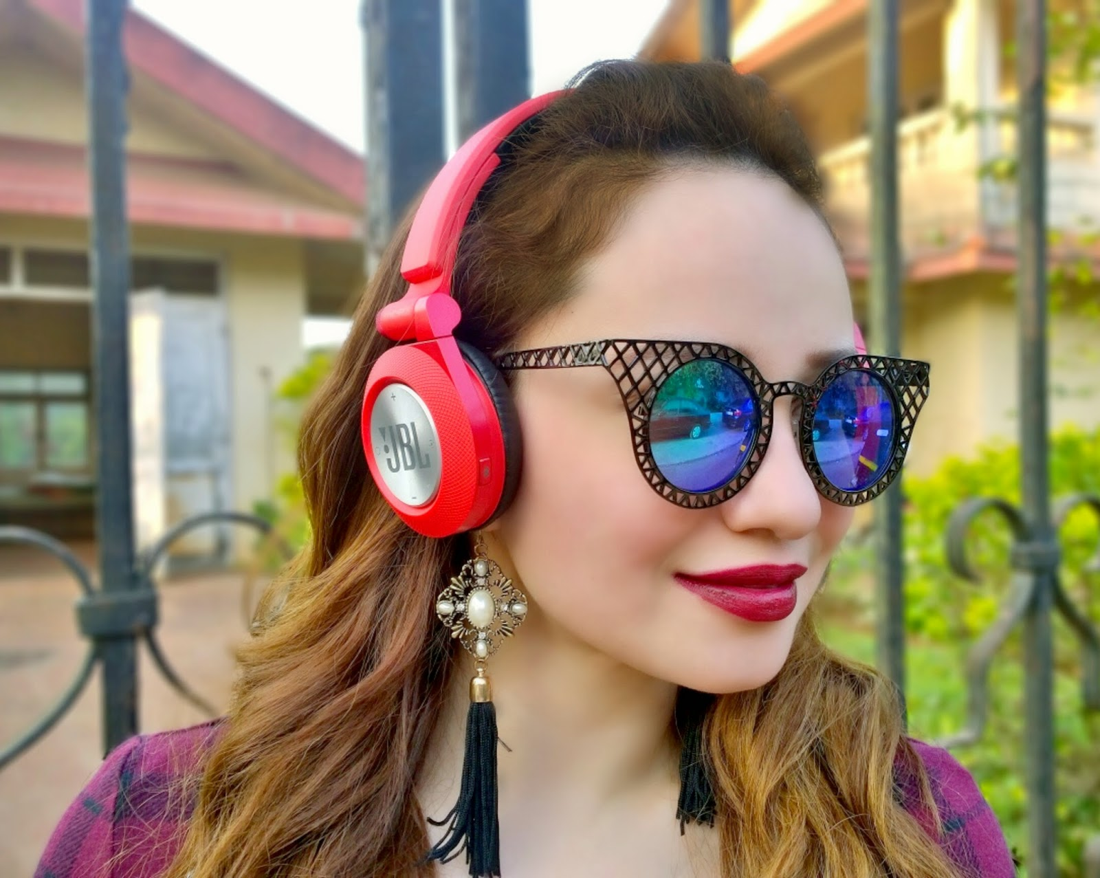 Candy Red JBL Wireless Headphones, Cat Eye Sunglasses, MAC Diva Lipstick