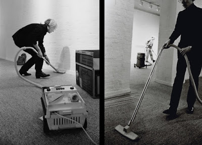 Andy Warhol vacuuming the carpet at Finch College (1972)