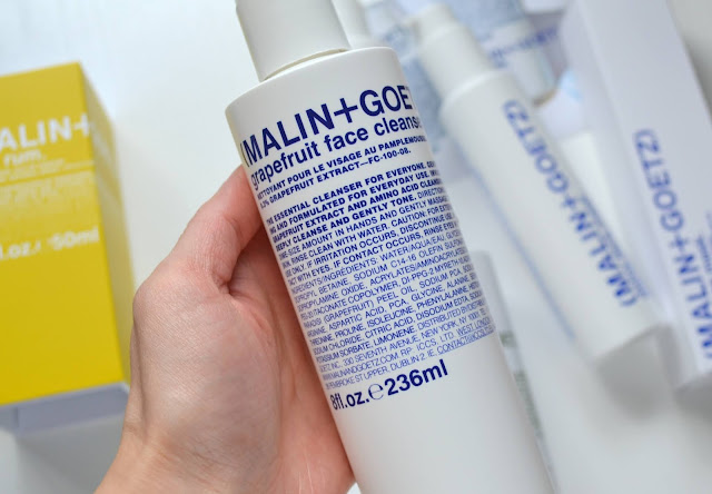 Close up of malin and goetz grapefruit face cleanser bottle
