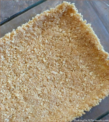 Lemon Fluff Refrigerator Bars (with a lower fat option) are a sweet, citrusy summer dessert. | Recipe developed by www.BakingInATornado.com | #recipe #dessert