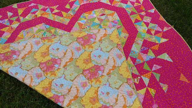 Exploding Heart quilt in Kaffe Fassett Parakeet fabrics