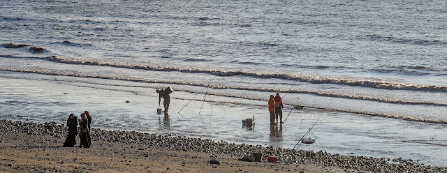 Photo of a fishing party on the beach at Maryport