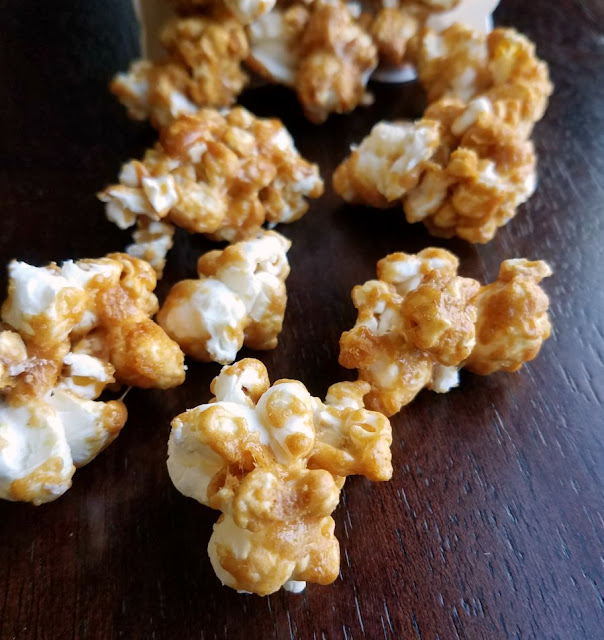 close up of crunchy peanut butter coated popcorn