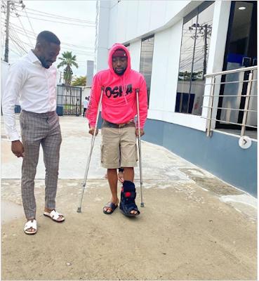 Davido fractures his leg,
