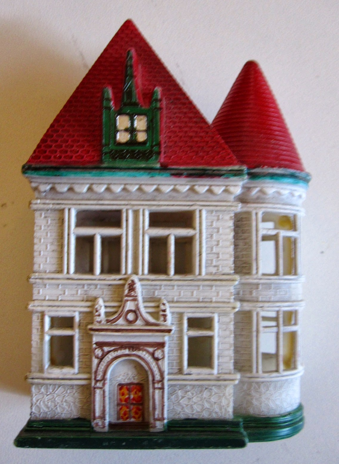 Plastic dolls' house for a dolls' house,