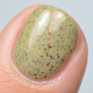 dusty green nail polish with flakies