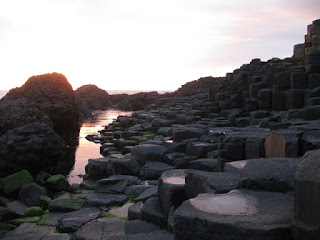Sunset colors reflected into pools and puddles, Giant's Causeway, Northern Ireland