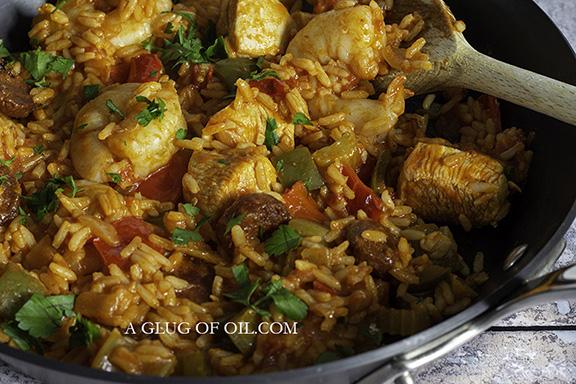 Jambalaya cooking in a pan