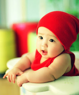 Adorable baby in red cap