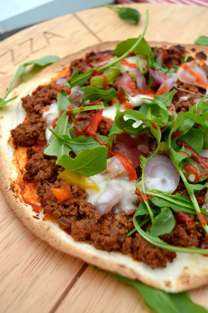 tortillas used as pizza bases topped with spicy beef, veg and cheeses