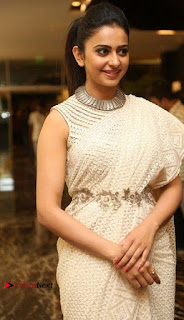 Actress Rakul Preet Singh Stills in White Dress at Winner Pre Release Function  0015.jpg