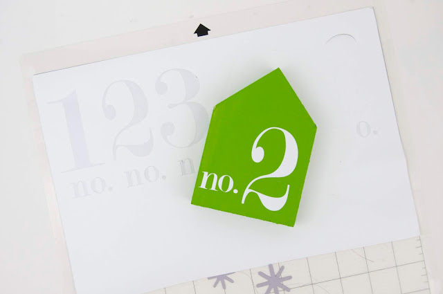 Painted wooden houses with viny numbers. Tutorial and supply list included. By Jen Gallacher for www.jengallacher.com #woodenhouse #acrylicpaint #diycraft #vinyl #silhouette