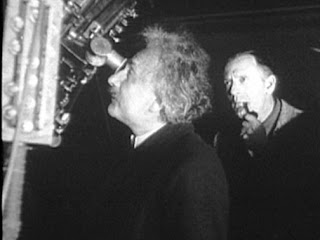 Albert Einstein and Edwin Hubble
