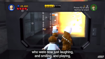 "A screen shot of a team playing Lego Star Wars. Subtitles read ""who were now just laughing and smiling and playing""."
