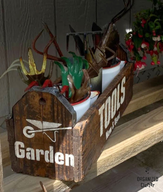 Photo of stenciled Garden Tools Toolbox filled with vintage garden tools