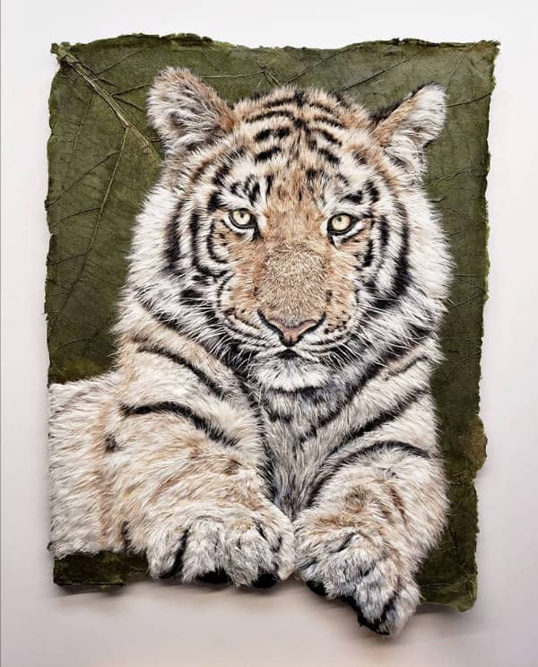 tiger portrait composed of individual paper fibers