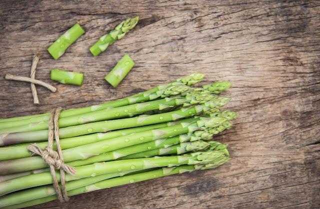 a bunch of asparagus alongside some scraps