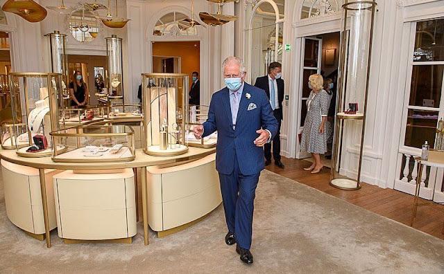 The Duchess of Cornwall wore a floral print cotton caftan dress, she carries Bottega Veneta bag