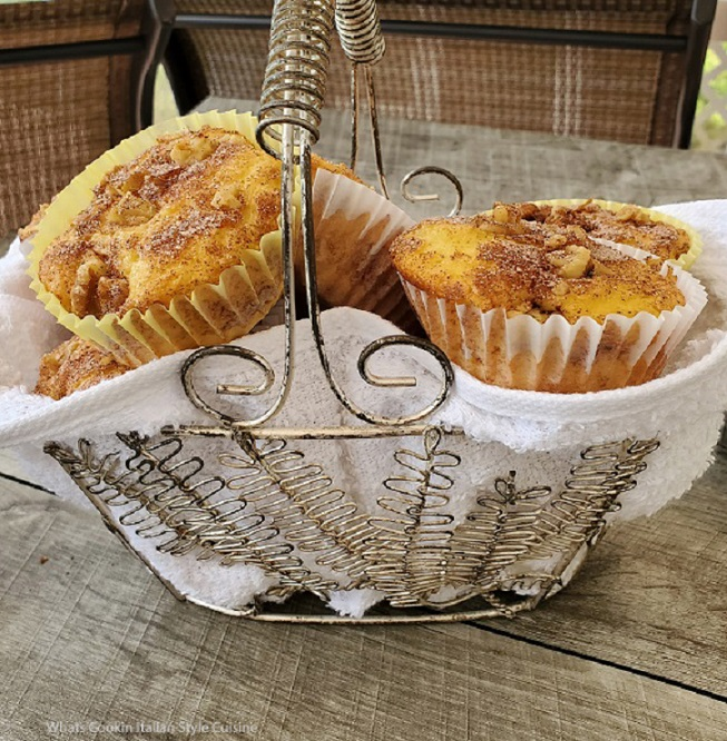 this is a wired silver basket full of semi homemade doctored coffee cake cupcakes