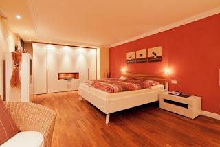 Dormitorio naranja crema