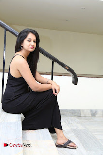 Actress Nikita Bisht Pictures in Black Long Dress at Akritti Elite Exhibition Launch  0067