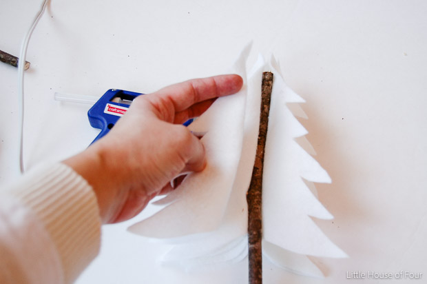 Gluing felt to sticks to make trees
