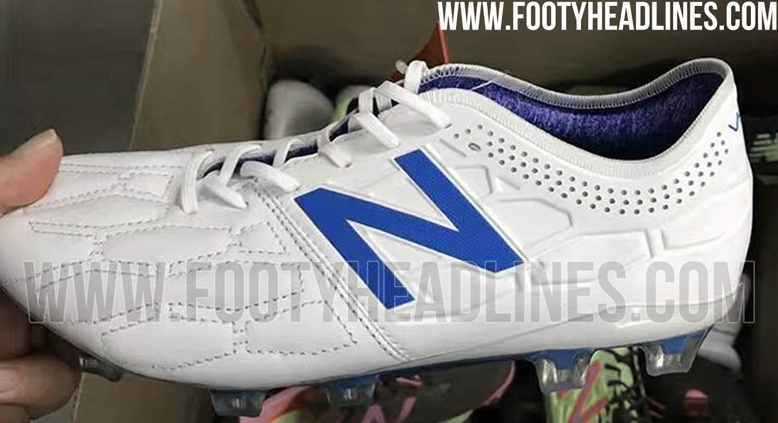 25c4b2a4b This image shows the white and blue New Balance Visaro 2 Kangaroo leather  boot.