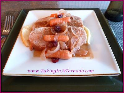 Crockpot Fruited Pork Roast | recipe developed by www.BakingInATornado.com | #recipe #dinner