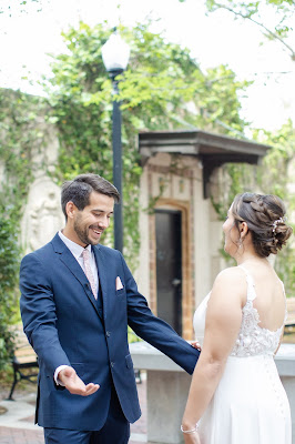 groom smiling during first look with bride