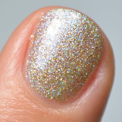 silver holographic nail polish with shimmer swatch