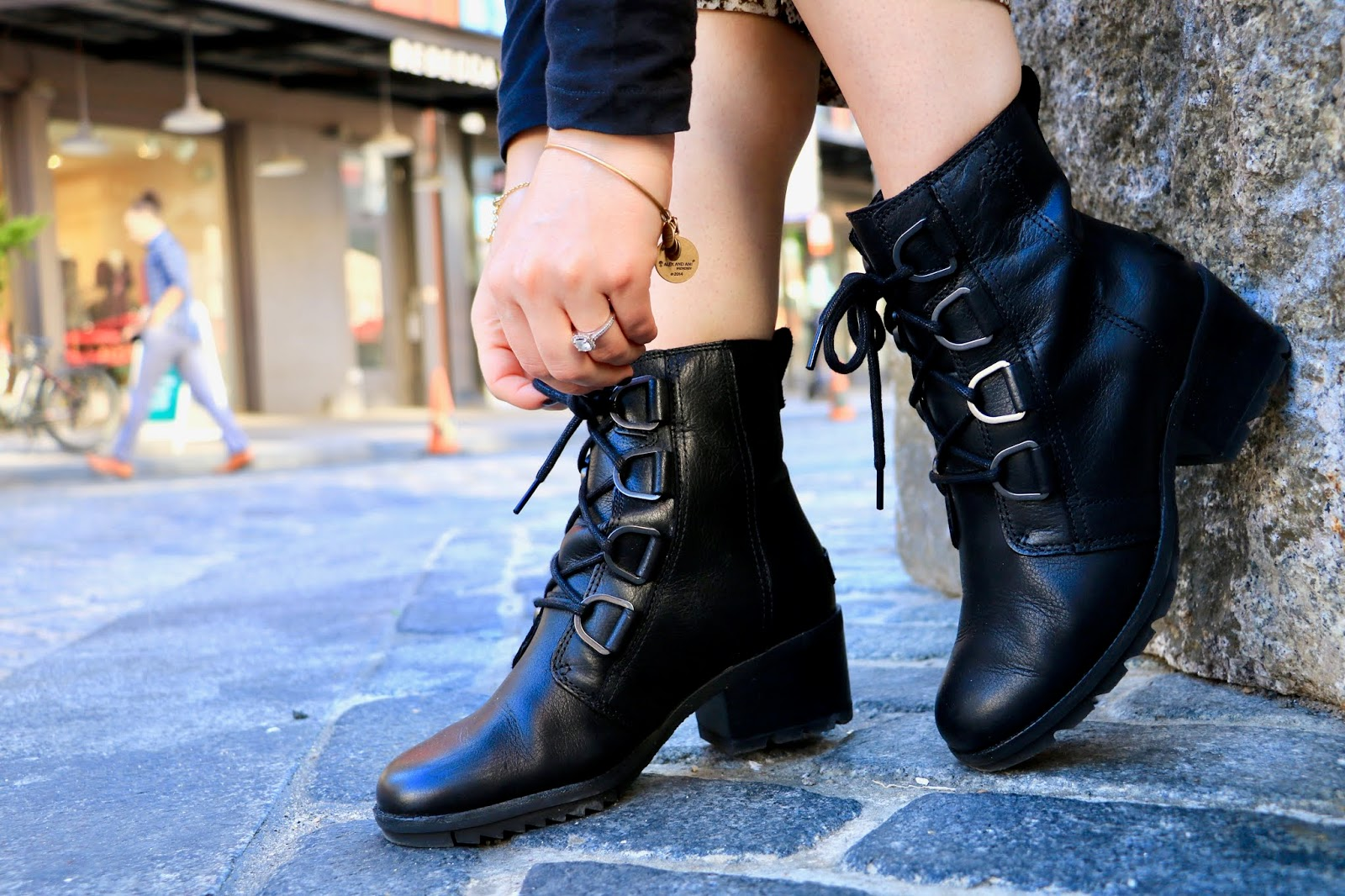 Nyc fashion blogger Kathleen Harper wearing sorel black lace-up boots.