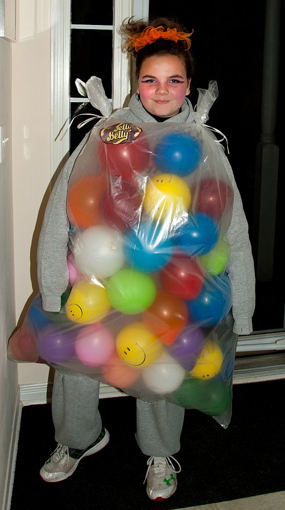 A young girl dressed for halloween as a bag of jelly belly jelly beans.