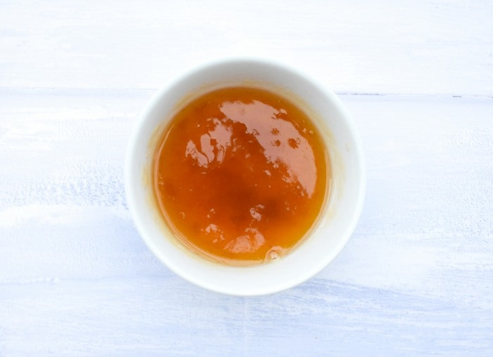 Apricot jam in a small bowl