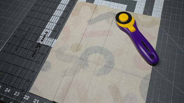 Cutting canvas to make key fobs