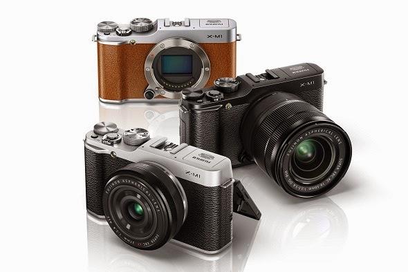 Fotografia della Fujifilm X-M1 nei tre colori, nero, argento e marron