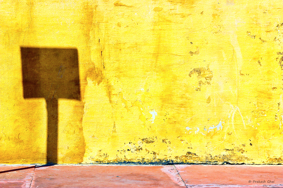 A minimalist photo of the Shadow of a sign board at Jantar Mantar Jaipur