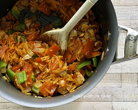 carrots, onions, chilli and peppers in a pan
