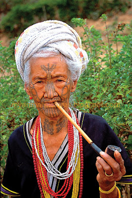 old Chin lady smoking pipe