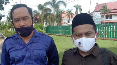 Anggota DPRD Bungo Fraksi Partai Nasdem Bagikan masker Pada Masyarakat.