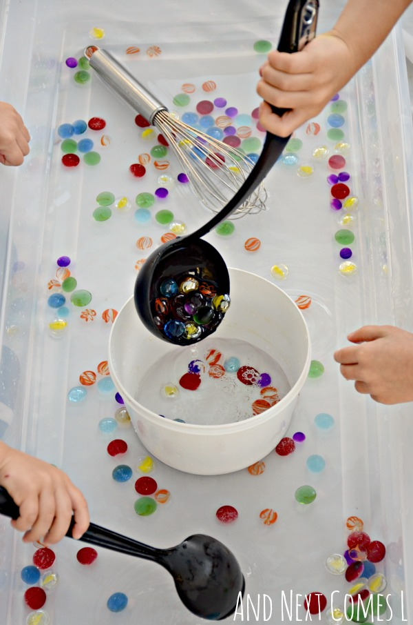 Fine motor practice for toddlers and preschoolers with a simple water sensory bin from And Next Comes L