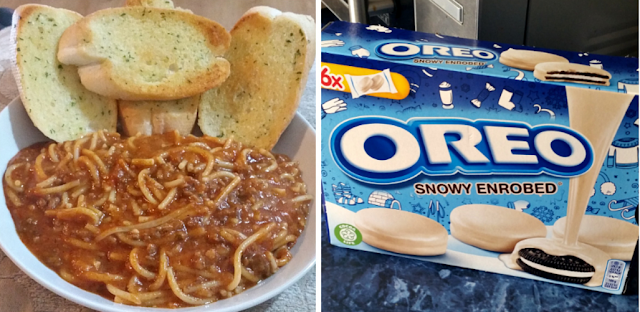a bowl of spaghetti bolognese and garlic bread and a box of the oreo white chocolate biscuts