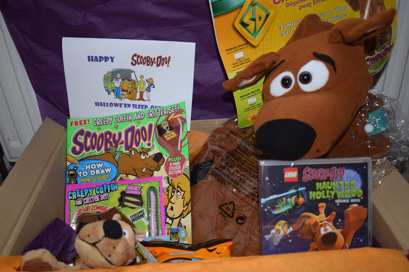 we have been sent a super cool box of scooby doo goodies to celebrate the children were delighted when the box arrived and couldnt wait to find out what