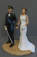 cake tops statuette personalizzate torte divisa sciabola orme magiche