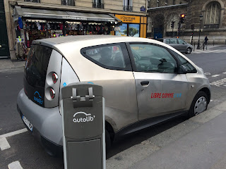 Pic of electric hire car service at roadside in Paris